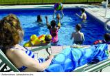 Woman and children in pool